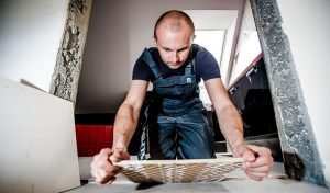 how to fix loose floor tiles